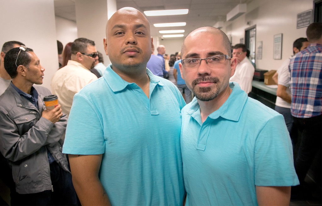 . Raul Aguilar, left, and Shawn Granado, both 33 of Pomona, wait in line to receive their marriage license at the Los Angeles County Registrar-Recorder/County Clerk office in Norwalk, Ca. July 1, 2013.   (SGVN staff photo by Leo Jarzomb)