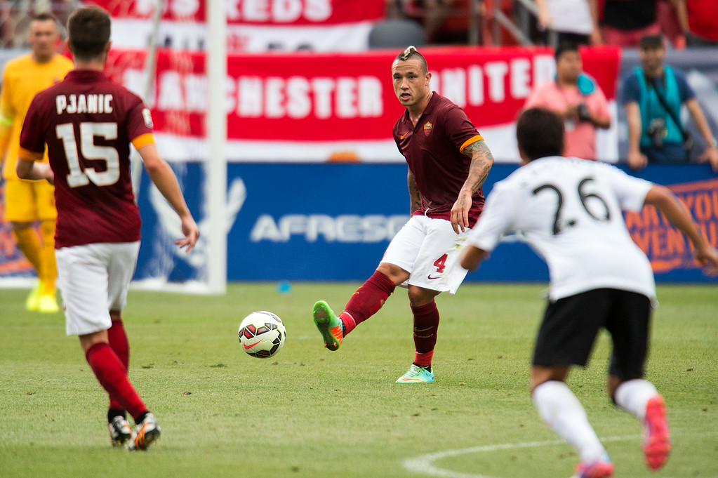 . Radja Nainggolan #4 of AS Roma passes the ball to Miralem Pjani� #15 of AS Roma during an exhibition match of the Guinness International Champions Cup against Manchester United at Sports Authority Field at Mile High on July 26, 2014, in Denver, Colorado. Machester United won 3-2. (Photo by Daniel Petty/The Denver Post)