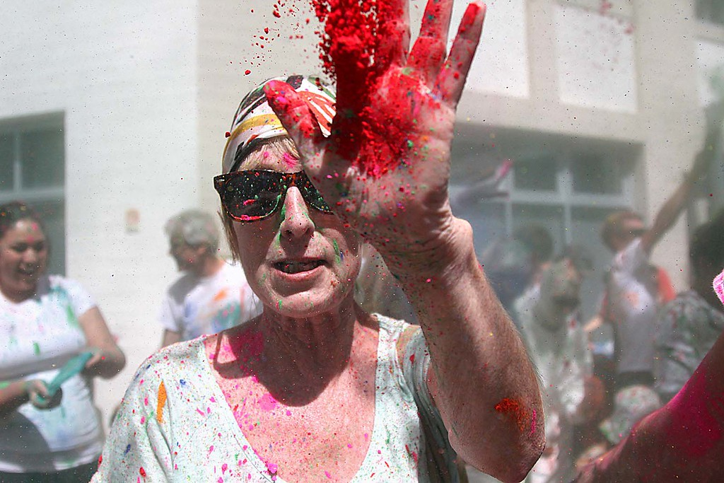". Hindu ""Holi\"" festival celebrates the arrival of spring with participants throwing handfuls of colored powder in the air and at each other at the Museum of Art and History in Santa Cruz, Calif., on Saturday, March 30, 2013.