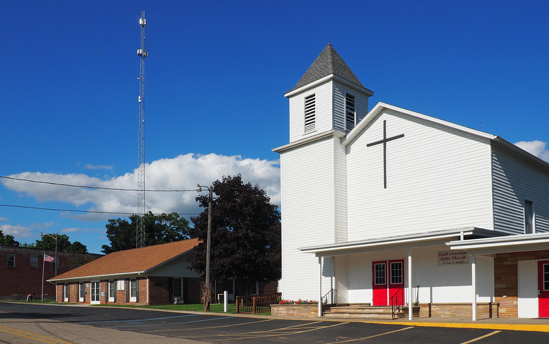 Jefferson Township Hall to the left of Faith Covenant Bible Church in Osseo MI