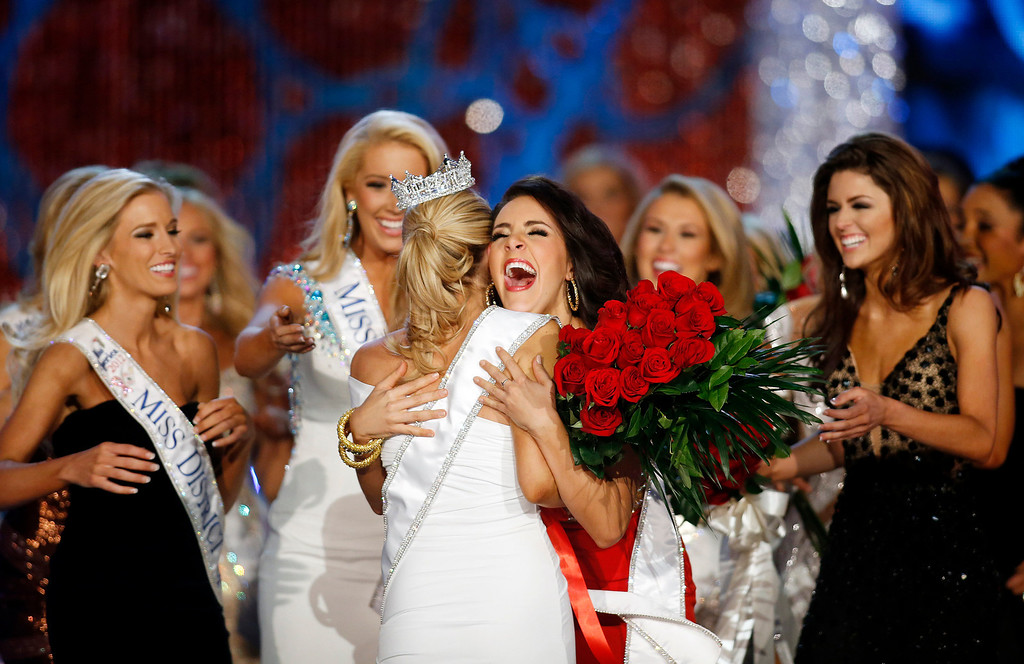 . Miss Georgia Leighton Jordan, center, congratulates Miss New York Mallory Hytes Hagan for winning the Miss America 2013 pageant on Saturday, Jan. 12, 2013, in Las Vegas. (AP Photo/Isaac Brekken)