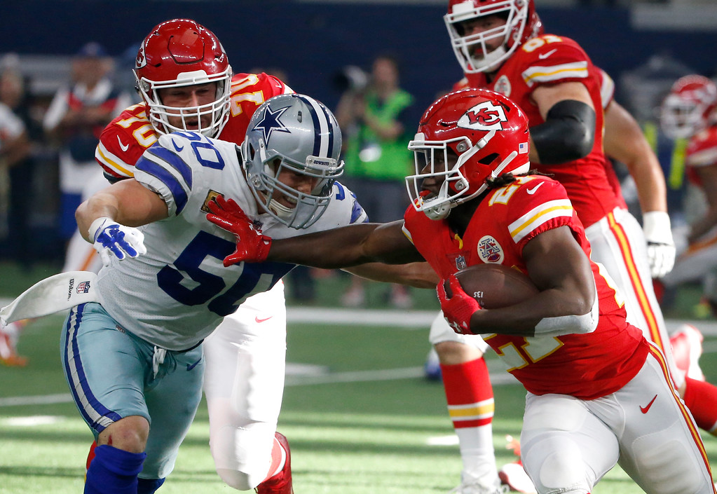 . Dallas Cowboys linebacker Sean Lee (50) attempts to stop Kansas City Chiefs running back Kareem Hunt (27) in the first half of an NFL football game, Sunday, Nov. 5, 2017, in Arlington, Texas. (AP Photo/Michael Ainsworth)