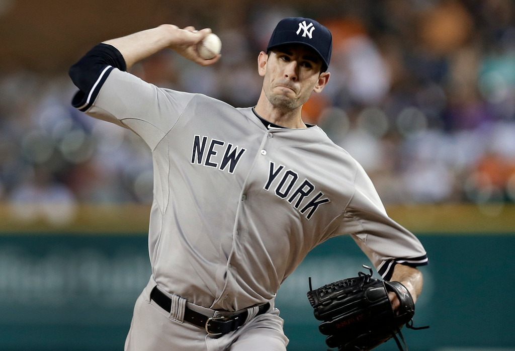 . New York Yankees pitcher Brandon McCarthy throws against the Detroit Tigers in the first inning of a baseball game in Detroit Tuesday, Aug. 26, 2014. (AP Photo/Paul Sancya)