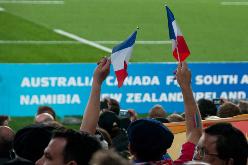 French national flag being waved at the 2011 Rugby World Cup Final in New Zealand