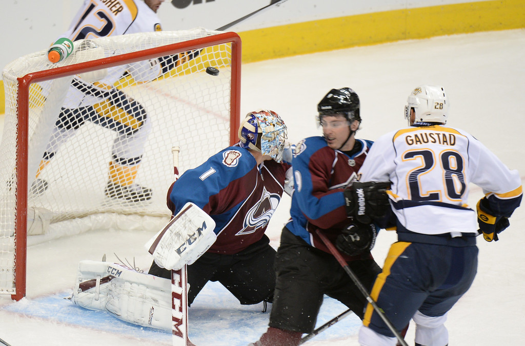 . DENVER, CO - OCTOBER 04 : Goalie Semyon Varlamov of Colorado Avalanche (1) is scored on by Paul Gaustad of the Nashville Predators (28) in the 2nd period of the game at the Pepsi Center. Denver, Colorado. October 4, 2013. (Photo by Hyoung Chang/The Denver Post)