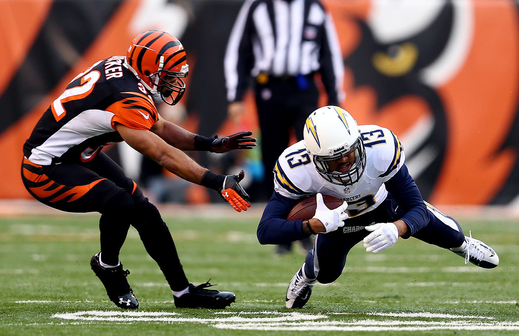 . Wide receiver Keenan Allen #13 of the San Diego Chargers carries the ball as defensive back Chris Crocker #32 of the Cincinnati Bengals defends during a Wild Card Playoff game at Paul Brown Stadium on January 5, 2014 in Cincinnati, Ohio.  (Photo by Andy Lyons/Getty Images)