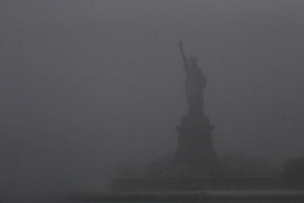 . The Statue Of Liberty is obscured during a snowstorm that is moving through the Northeast on January 21, 2014 in New York City.   (Photo by Spencer Platt/Getty Images)