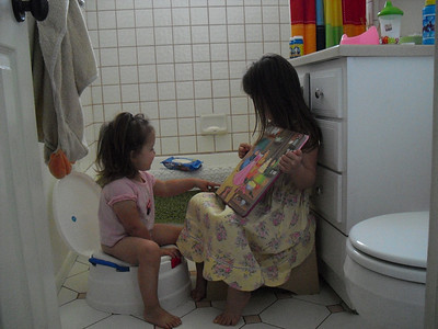 Kelli Reading to Alyce on the Potty