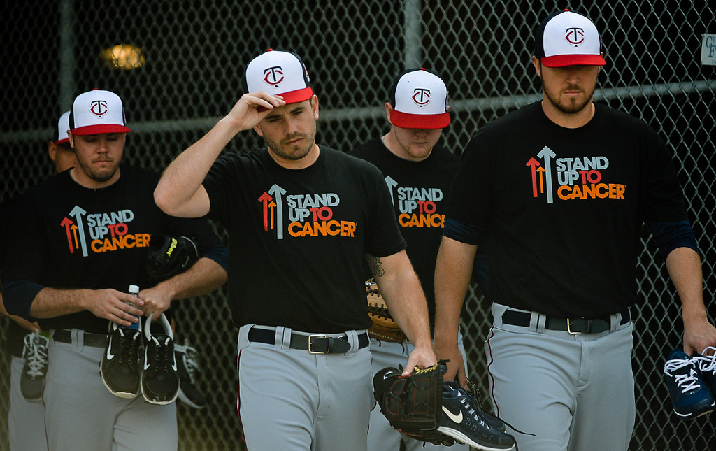 . All 110 players and staff wore T-shirts shirts in honor of Twins general manager Terry Ryan, who was recently diagnosed with a cancerous lymph node on his neck\' during the squad\'s first full-team workout. (Pioneer Press: Ben Garvin)