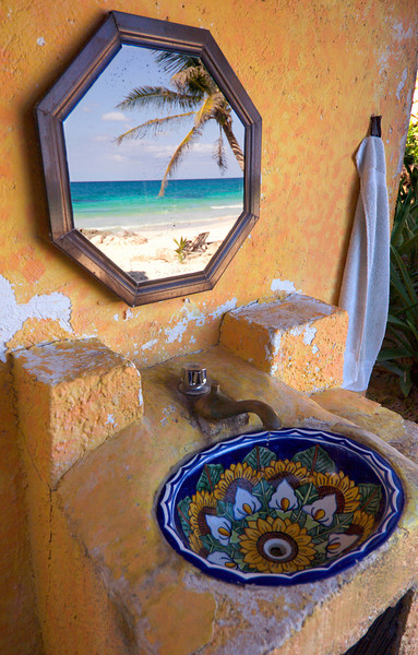 Reflection of Paradise - Mexico  The mirror above a small outdoor sink reflects the pristine white sand beaches near Tulum, Mexico.