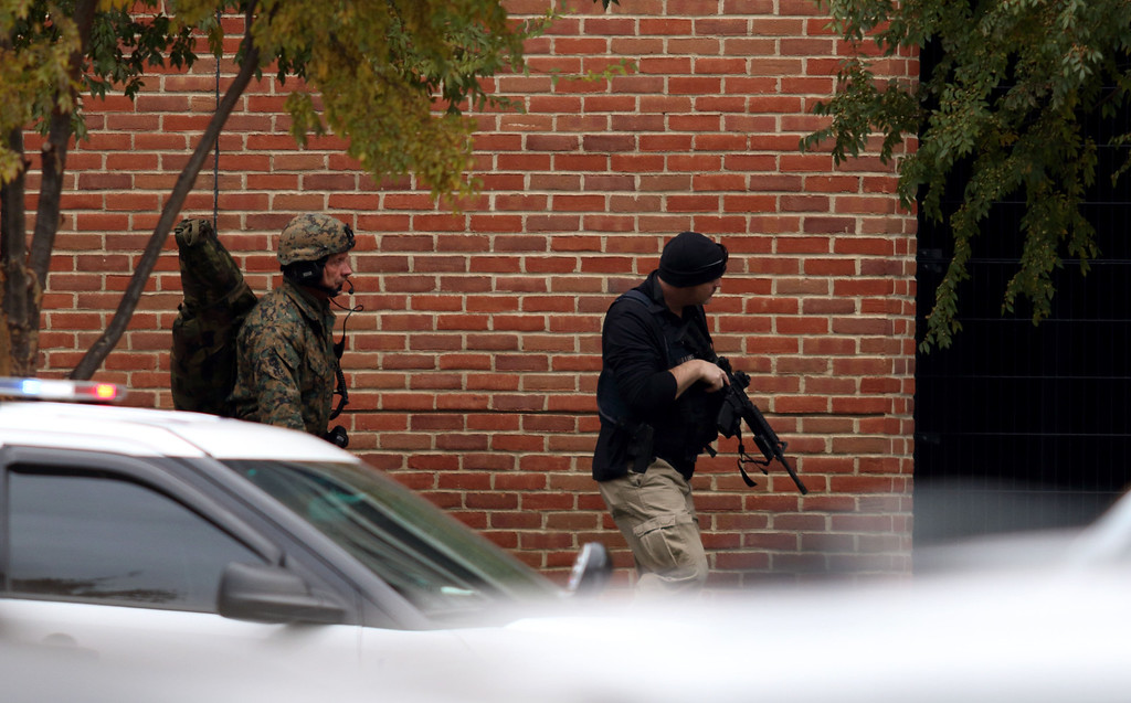 . Law enforcement officials are seen outside of a parking garage on the campus of Ohio State University as they respond to an active attack in Columbus, Ohio, on November 28, 2016. Eight people were injured when an attacker apparently drove into a crowd at Ohio State University on Monday, triggering an hours-long lockdown before authorities declared the campus secure. Law enforcement shot and killed one suspect, according to local television station WBNS, which reported that police led two people out in handcuffs from a garage they had surrounded on the university\'s main campus in Columbus.   (PAUL VERNON/AFP/Getty Images)