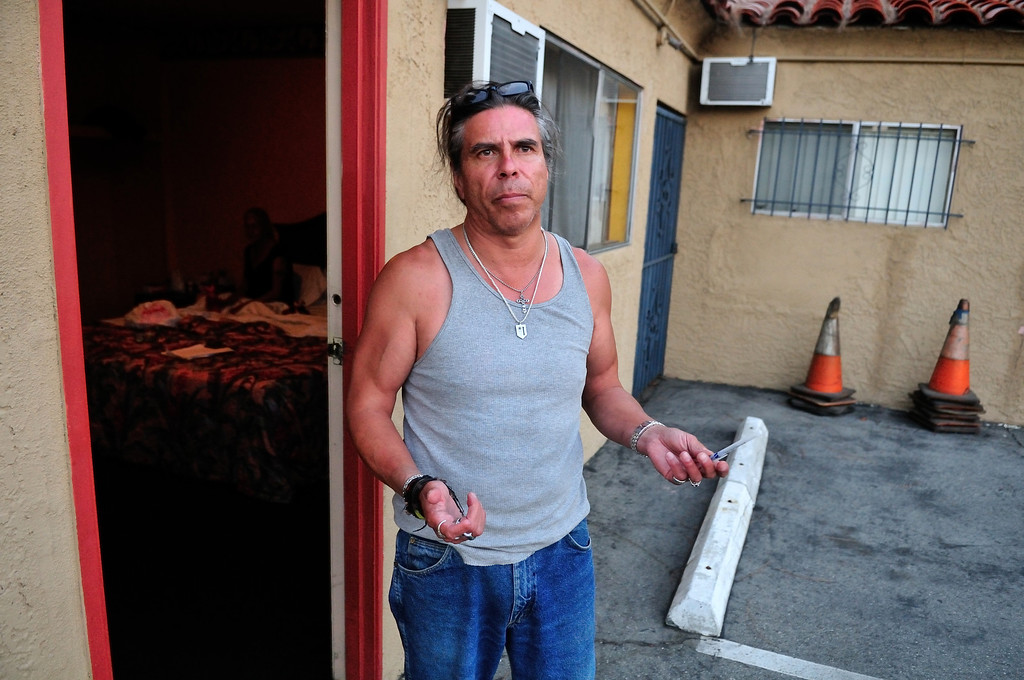 . Tim Grobaty fan, Aldred Esquivel, outside his girlfriend\'s room at the El Capitan Motor Inn.Photo by Thomas Wasper for the Press Telegram