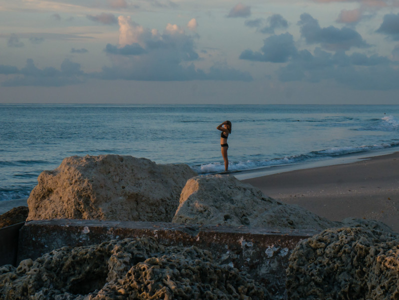 An early beach goer stands at the shoreline after finishing a sunrise swim at Midtown Beach in Palm Beach on Thursday, August 17, 2017. (Joseph Forzano / Deep Creek Images)