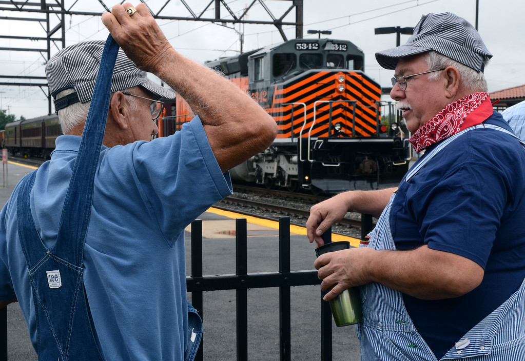 . Reading Company Technical & Historical Society members Don Crabtree ,R, and Bob Francis check out the New Hope & Ivyland Excursion Train during the Lansdale Founders Day celebration and on Saturday August 23,2014. Photo by Mark C Psoras/The Reporter