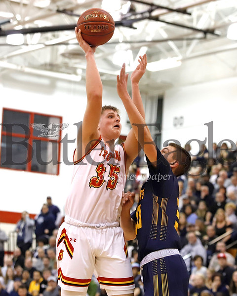 North Catholic's Jake Tomer extends for a shot over South Allegheny's Ayden Sloss in Monday night's WPIAL Playoff win. Seb Foltz/Butler Eagle