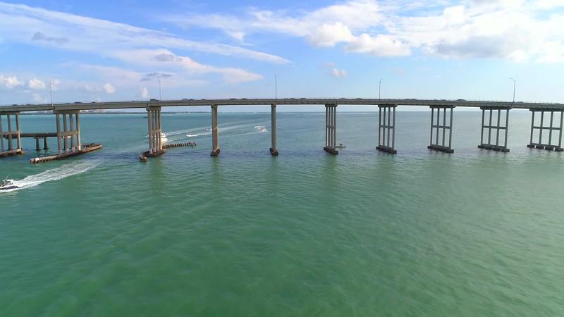 Aerial drone flying under a bridge