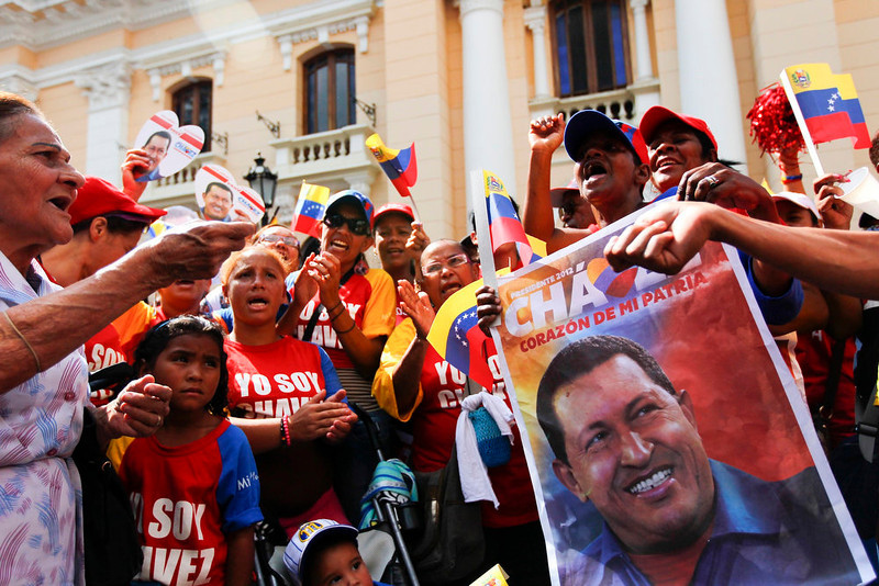 . Supporters of Venezuelan President Hugo Chavez gather at Plaza Bolivar in Caracas February 18, 2013. Chavez made a surprise return from Cuba on Monday more than two months after surgery for cancer that has jeopardized his 14-year rule of the South American OPEC member. The 58-year-old socialist leader underwent a six-hour operation in Cuba on December 11 and had not been seen or heard in public until photos of him were published on Friday. REUTERS/Carlos Garcia Rawlins