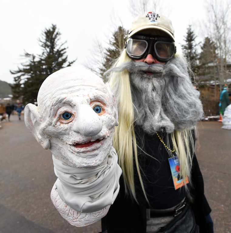 . Brent Warren with frozen grandpa directs the parade on Saturday during 2018 Frozen Dead Guy Days in Nederland. The festival continues on Sunday. For more photos, go to dailycamera.com. Cliff Grassmick  Photographer  March 10, 2018