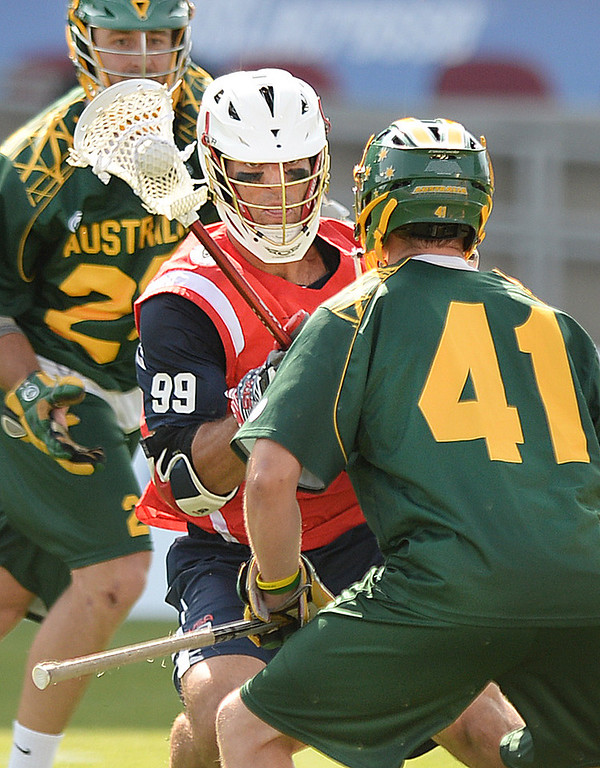 . COMMERCE CITY, CO - JULY 17: US midfielder Paul Rabil (99) made a move on Australia goalie Warren Brown (41) in the first half.  Team USA faced Australia in a FIL World Championship semifinal game Thursday night, July 17, 2014.  Photo by Karl Gehring/The Denver Post