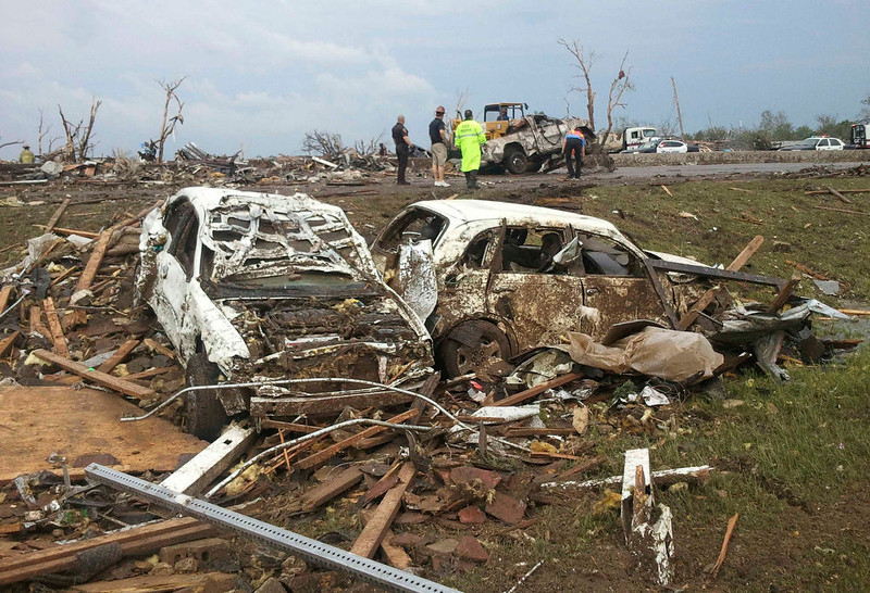 . Destroyed cars are seen after a huge tornado struck Moore, Oklahoma May 20, 2013. A huge tornado with winds of up to 200 miles per hour devastated the Oklahoma City suburb of Moore on Monday, ripping up at least two elementary schools and a hospital and leaving a wake of tangled wreckage. At least four people were killed, KFOR television said, citing a reporter\'s eyewitness account, and hospitals said dozens of people were injured as the dangerous storm system threatened as many as 10 U.S. states with more twisters.  REUTERS/Gene Blevins