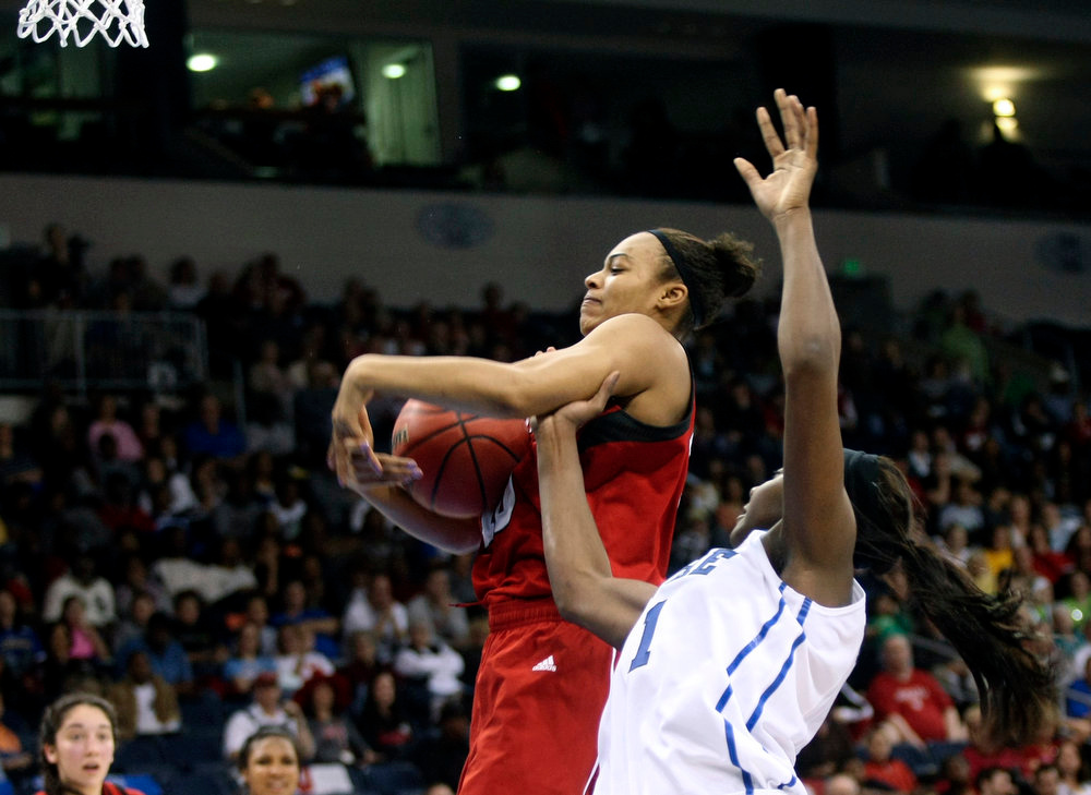 . Nebraska forward Meghin Williams, left, tries to control a rebound as Duke center Elizabeth Williams (1)  defends during second half of a regional semifinal game of the women\'s NCAA college basketball tournament Sunday, March 31, 2013, in Norfolk, Va. Duke won 53-45.  (AP Photo/Jason Hirschfeld)