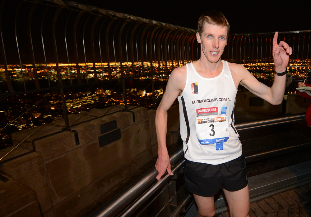 . Australia\'s Mark Bourne celebrates after crossing the finish line winning the 36th annual Empire State Building run-up in New York, February 6, 2013. Some 600 competitors entered the race which consist of racing up 86 floors, 1,576 steps, and 1,050 feet from the lobby to the iconic 86th floor Observatory.  EMMANUEL DUNAND/AFP/Getty Images