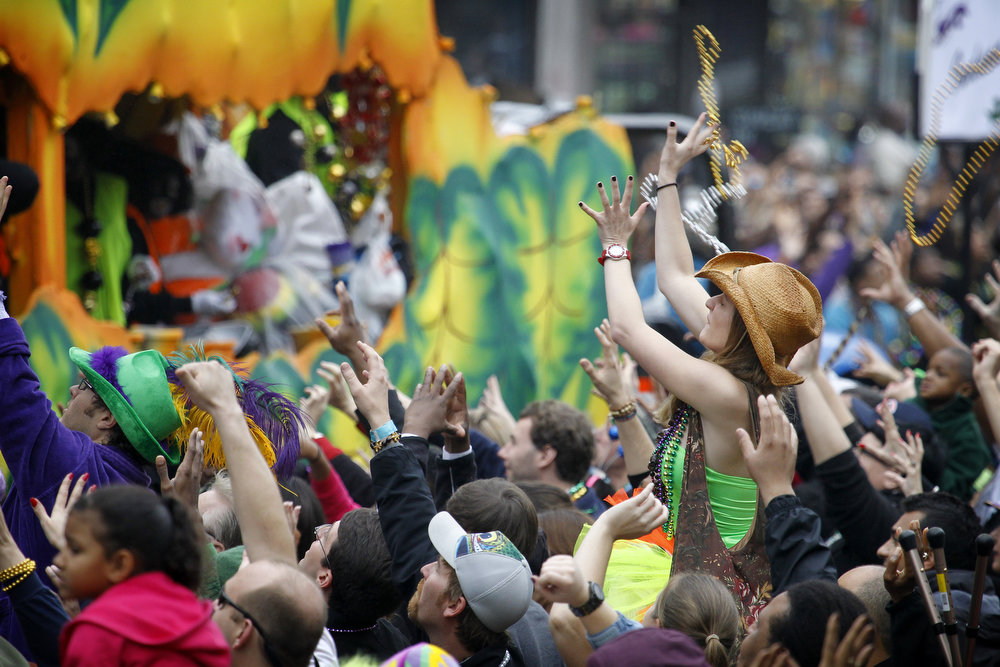 . A parade goer catches a pair of beads tossed from a float in the Krewe of Zulu parade on Mardi Gras Day. Fat Tuesday, the traditional celebration on the day before Ash Wednesday and the beginning of Lent, is marked in New Orleans with parades and marches through many neighborhoods in the city. (Photo by Rusty Costanza/Getty Images)