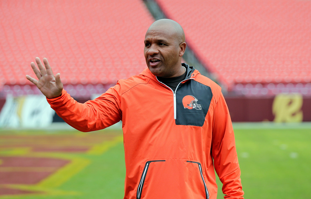 . Cleveland Browns head coach Hue Jackson waves before an NFL football game against the Washington Redskins Sunday, Oct. 2, 2016, in Landover, Md. (AP Photo/Mark Tenally)