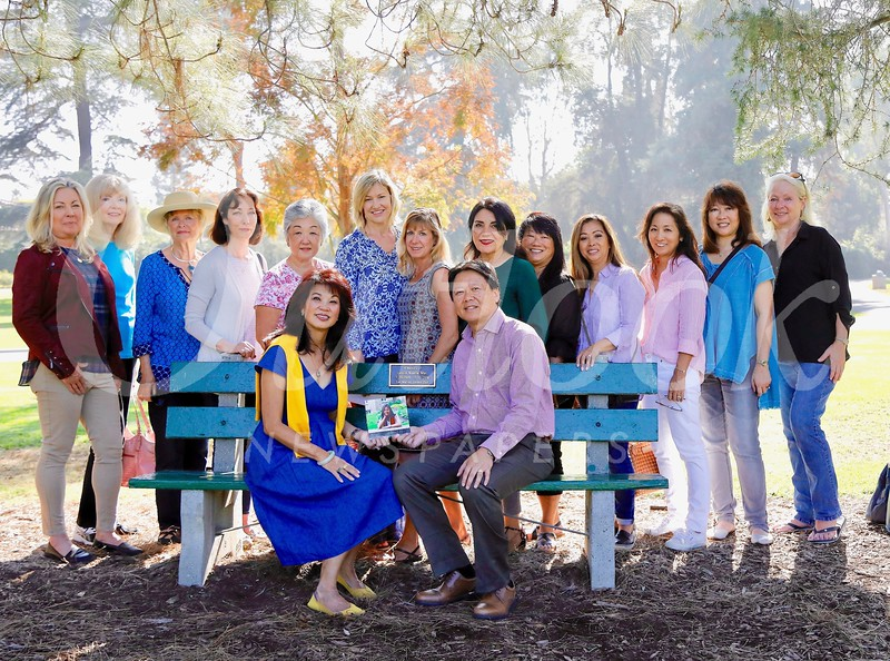 Attendees at the dedication of a Lacy Park bench commemorating the late Leslie Noelle LienJun Mar included her parents, Patricia Tom Mar (seated) and Harry Mar. Back: Gretchen Shepherd Romey, Sandy Dimkich, Evelyn Pederson, Connie Knott, Linda Parmenter, Debra Spaulding, Maria De Jesu, Shana Bayat, Mary Swanton, Dina McCall, Karen Quon, Linda SooHoo-Dang and Kathleen Bescoby.