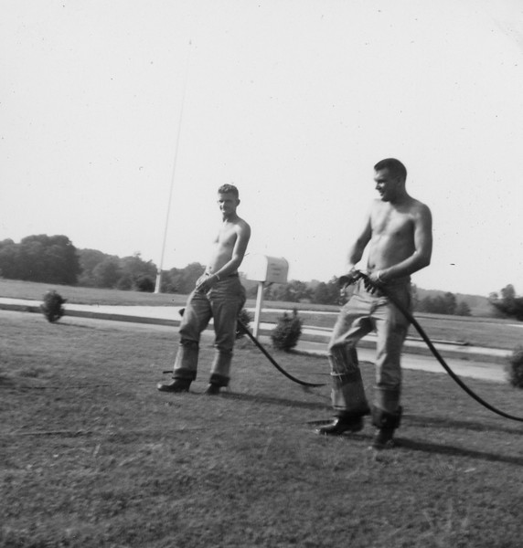 J.B. and Carlton with hose