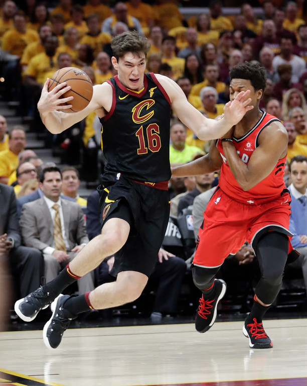 . Cleveland Cavaliers\' Cedi Osman (16), from Turkey, catches a pass against Toronto Raptors\' Kyle Lowry in the first half of Game 4 of an NBA basketball second-round playoff series, Monday, May 7, 2018, in Cleveland. (AP Photo/Tony Dejak)