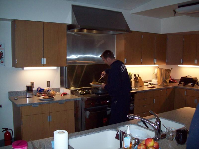Sparky prepping a gourmet meal.jpg