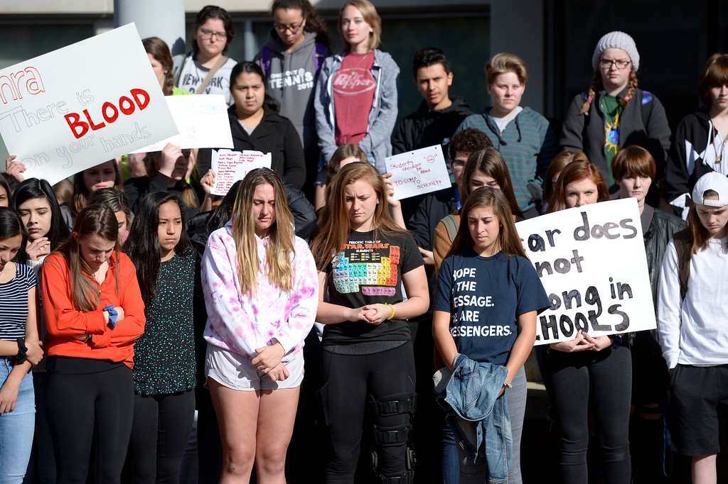 . Longmont High School students stand outside the main entrance Wednesday morning during National Walkout Day. To view more photos visit timescall.com. Lewis Geyer/Staff Photographer March 14, 2018