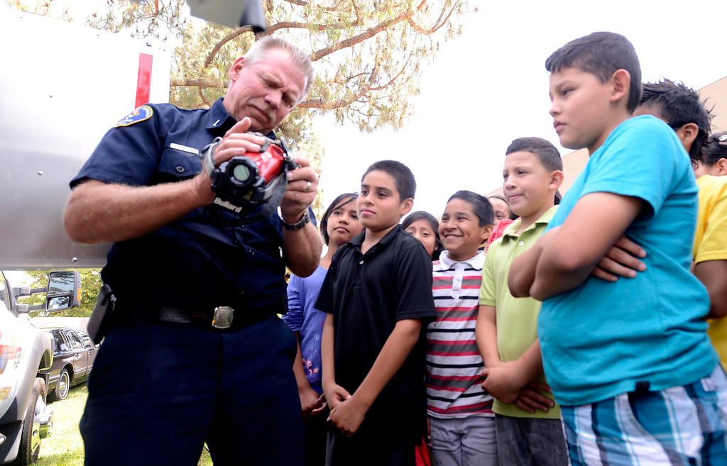 """. Brian Otter of San Bernardino County Fire/ Hazardous Material speaks to students about his Thermal Imaging Camera (TIC) during the final day of the 19th Annual Career Awareness Week at Lankershim Elementary School in Highland June 6, 2013. \""""We give them a background on how to achieve the goals of working for a fire agency,\"""" says Otter. GABRIEL LUIS ACOSTA/STAFF PHOTOGRAPHER."""
