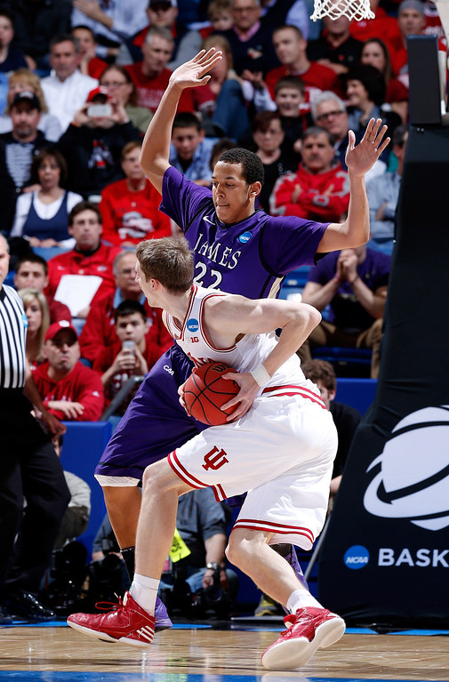 . DAYTON, OH - MARCH 22: Cody Zeller #40 of the Indiana Hoosiers drives with the ball against Taylor Bessick #22 of the James Madison Dukes in the first half during the second round of the 2013 NCAA Men\'s Basketball Tournament at UD Arena on March 22, 2013 in Dayton, Ohio.  (Photo by Joe Robbins/Getty Images)