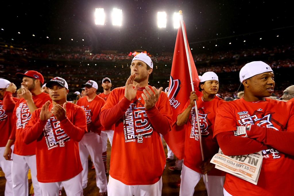 . ST LOUIS, MO - OCTOBER 18:  (C) David Freese #23 of the St. Louis Cardinals celebrates after the Cardinals defeat the Los Angeles Dodgers 9-0 in Game Six of the National League Championship Series at Busch Stadium on October 18, 2013 in St Louis, Missouri.  (Photo by Elsa/Getty Images)