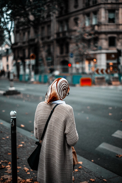 lady at crossing with headscarf paris.jpg