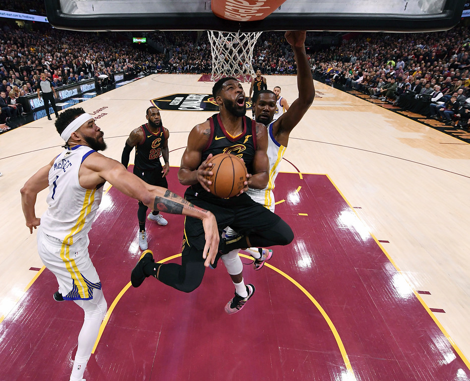 . Cleveland Cavaliers center Tristan Thompson (13) goes to the basket between Golden State Warriors center JaVale McGee (1) and forward Kevin Durant during the first half of Game 3 of basketball\'s NBA Finals, Wednesday, June 6, 2018, in Cleveland. (Kyle Terada/Pool Photo via AP)
