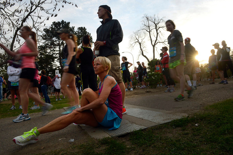 . Jane Molander stretches before the start of the Colfax Half Marathon that started and finished in City Park in Denver, CO. on May 19th, 2013.  The Colfax Marathon, the  Half Marathon and the Urban Ten-Miler were held in City Park in Denver, CO on May 19th, 2013. The popular running events, sponsored by Kaiser Permanente, were sold out and thousands of runners took part in all three races.  Temperatures were cool with cloudy skies making for record setting times on both the marathon and the half marathon by the winners.  (Photo by Helen H. Richardson/The Denver Post)