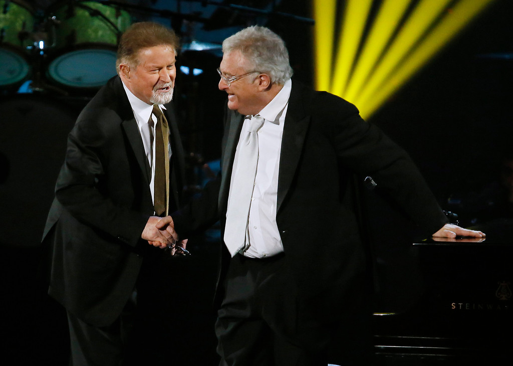 . Don Henley, left, shakes hands with Randy Newman, right, as Newman is inducted into the Rock and Roll Hall of Fame during the Rock and Roll Hall of Fame Induction Ceremony at the Nokia Theatre on Thursday, April 18, 2013 in Los Angeles. (Photo by Danny Moloshok/Invision/AP)