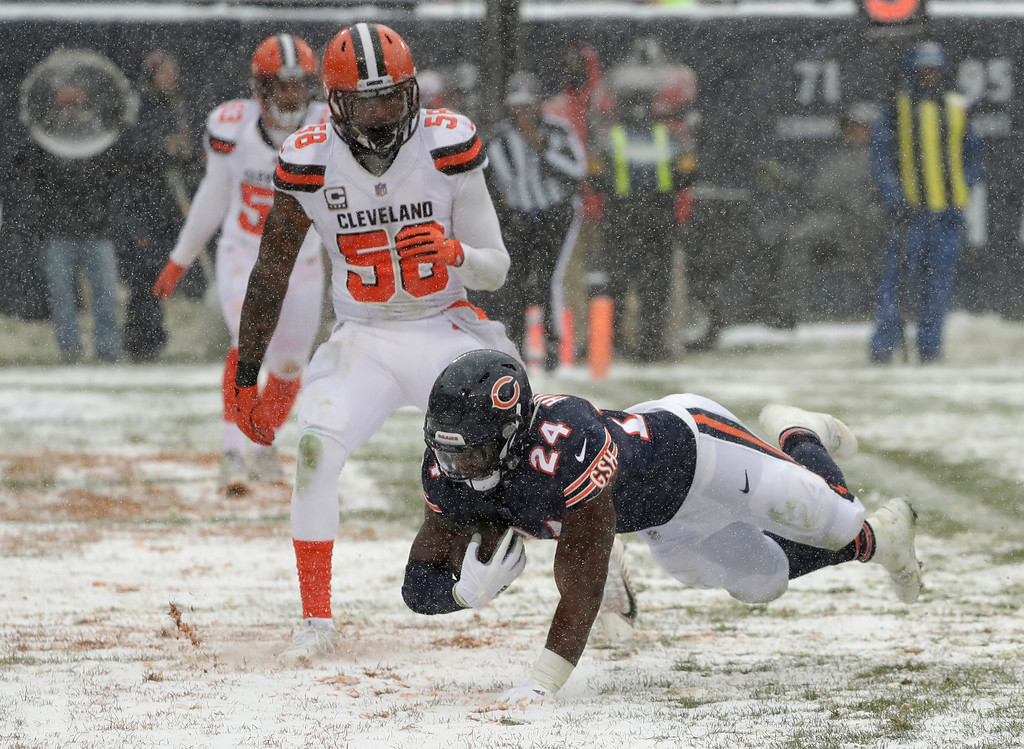 . Chicago Bears running back Jordan Howard (24) dives into the end zone for a rushing touchdown as Cleveland Browns outside linebacker Christian Kirksey (58) watches in the first half of an NFL football game in Chicago, Sunday, Dec. 24, 2017. (AP Photo/Charles Rex Arbogast)