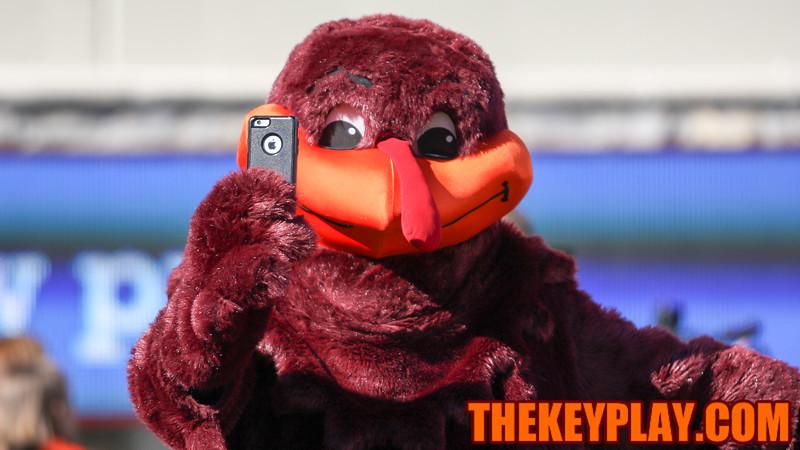 The Hokiebird poses for a selfie before the team runs onto the field. (Mark Umansky/TheKeyPlay.com)