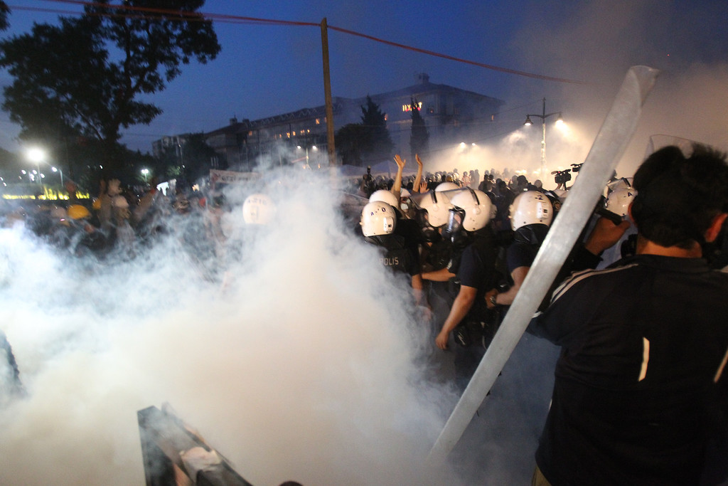 ". Police throw tear gas during clashes as they try to evacuate protestors from the Gezi Park  in Istanbul, Saturday,  June 15, 2013. Riot police fired water cannons and tear gas as they drove protesters out of Istanbul\'s Taksim Square and neighboring Gezi Park on Saturday, an intervention that came shortly after the prime minister warned that security forces ""know how to clear\"" the area, which had become a symbol of the biggest anti-government protests in decades. (AP Photo/Thanassis Stavrakis)"
