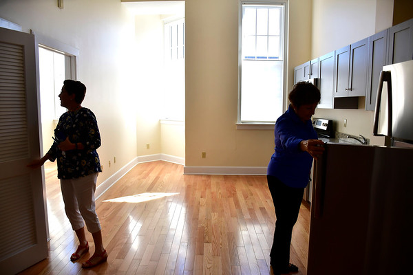 9/18/2019 Mike Orazzi | Staff Councilwoman Mary Fortier and Marie O'Brien look over one of the apartments during the opening of Bingham Place in Bristol on Wednesday morning.