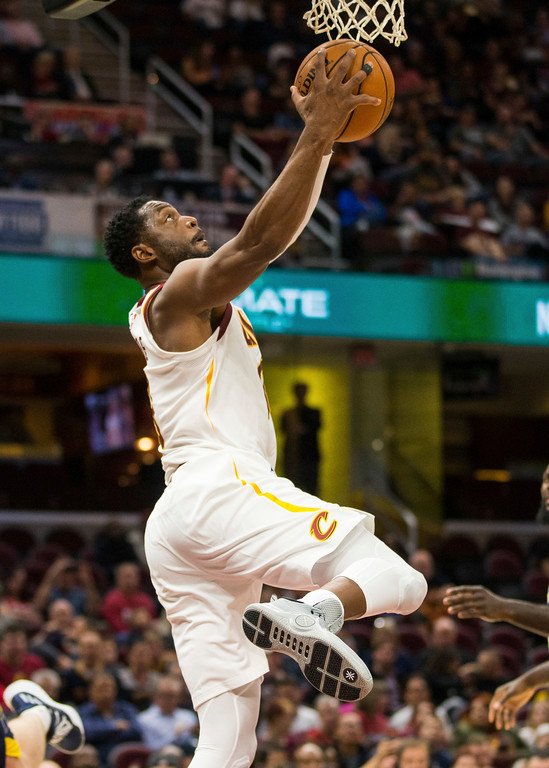 . Cleveland Cavaliers\' Dwyane Wade (9) makes a layup under the basket against the Indiana Pacers during the second quarter of an NBA preseason basketball game, Friday, Oct. 6, 2017, in Cleveland. (AP Photo/Scott R. Galvin)
