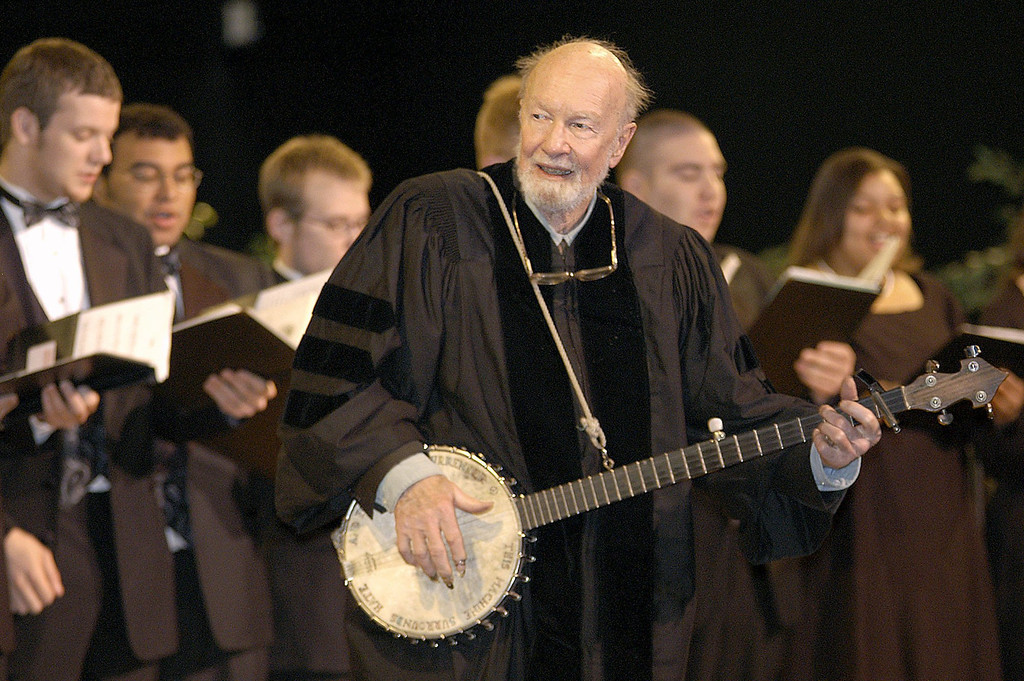 ". File-This May 10, 2003 file photo shows folk singer Pete Seeger performing""When the Saints Go Marching In\"" with the Saint Rose Chamber Singers during commencement ceremonies for the College of St. Rose at the Empire State Plaza in Albany, N.Y.   The American troubadour, folk singer and activist Seeger  died Monday Jan. 27, 2014, at age 94.  (AP Photo/Stewart Cairns, File)"