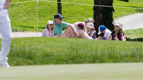 The Parker family enjoying the sun while dad watches the action beside the 18th green on Day 3 of the Asia-Pacific Amateur Championship tournament 2017 held at Royal Wellington Golf Club, in Heretaunga, Upper Hutt, New Zealand from 26 - 29 October 2017. Copyright John Mathews 2017.   www.megasportmedia.co.nz