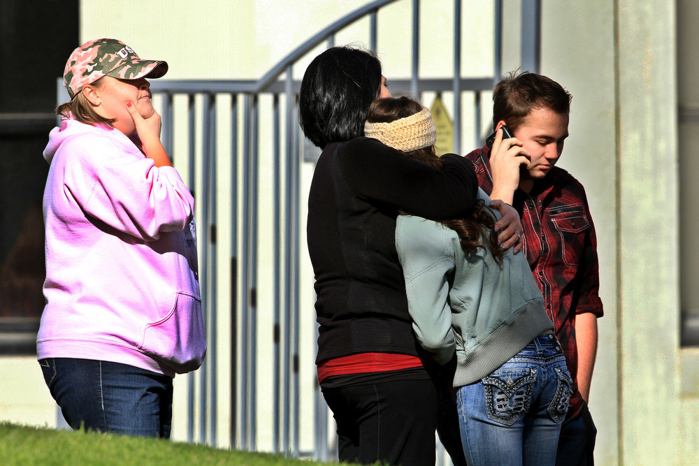 . Students and staff members comfort each other as they emerged from the school building at Taft Union High School in Kern County, California, on Thursday, January 10, 2013, after a student opened fire in a classroom. (Irfan Khan/Los Angeles Times/MCT)