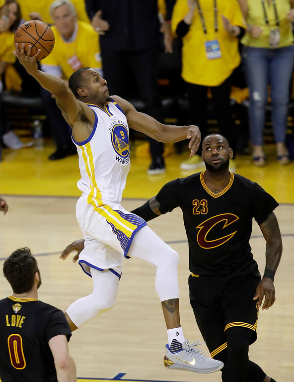 . Golden State Warriors forward Andre Iguodala (9) shoots over Cleveland Cavaliers forward LeBron James (23) during the first half of Game 5 of basketball\'s NBA Finals in Oakland, Calif., Monday, June 12, 2017. (AP Photo/Marcio Jose Sanchez)