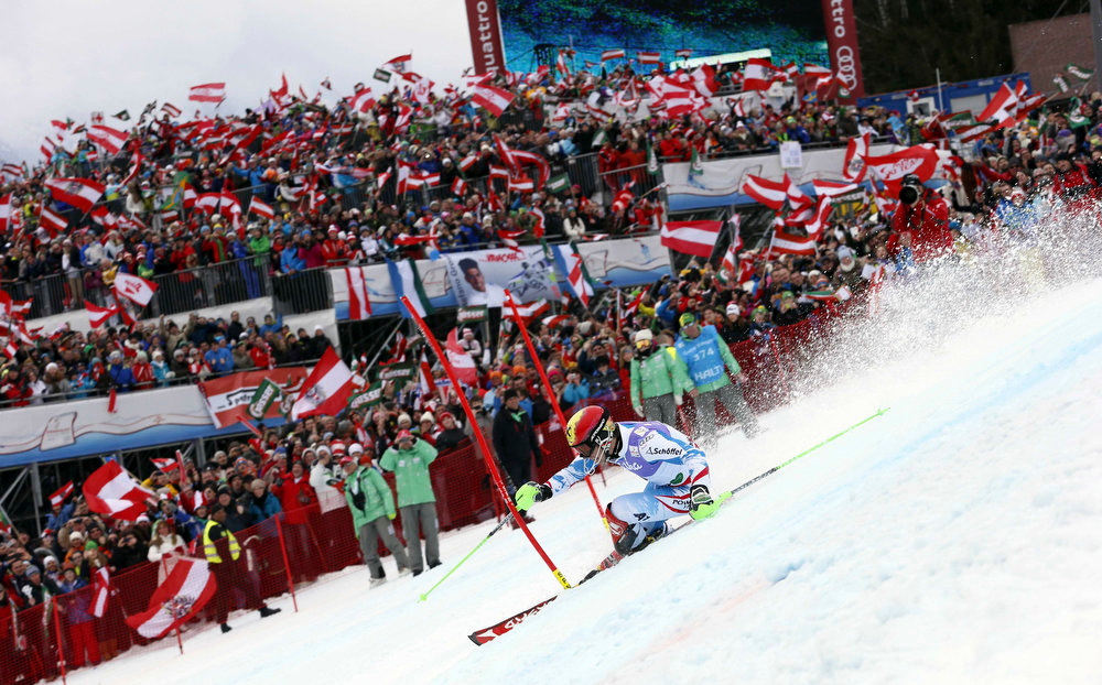 Description of . Austria's Marcel Hirscher clears a gate during the second run of the men's slalom, at the Alpine skiing world championships in Schladming, Austria, Sunday, Feb.17, 2013. Hirscher won the gold medal. (AP Photo/Alessandro Trovati)